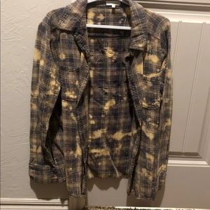 Distressed buckle plaid shirt